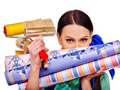 depositphotos_73849697-Builder-woman-with-wallpaper.