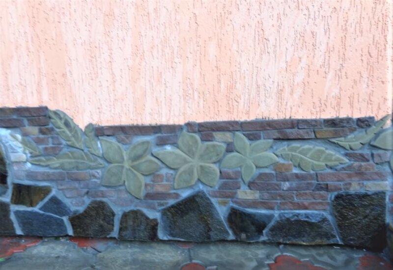 камень в сочетании с штукатуркой на фасаде